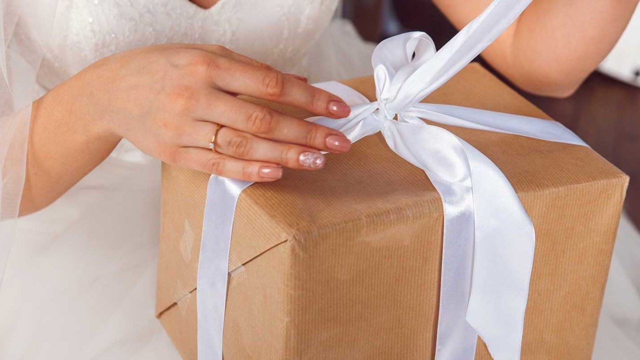 Bride opening up a wedding gift
