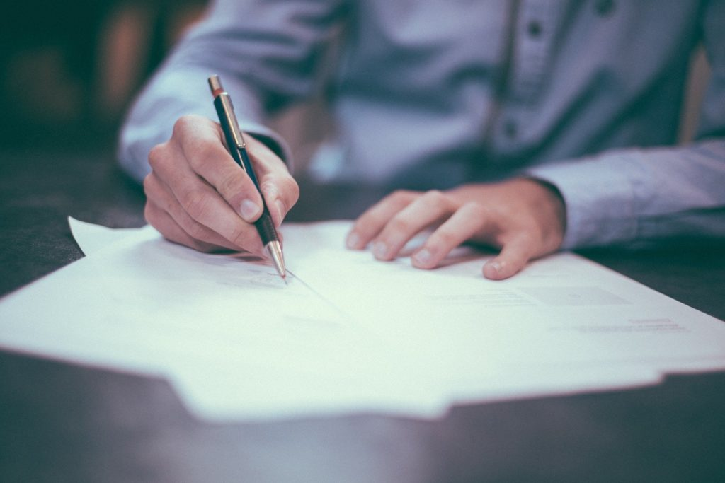 Maryland family law attorney signing divorce papers