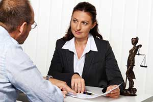 Maryland divorce attorney speaking with client
