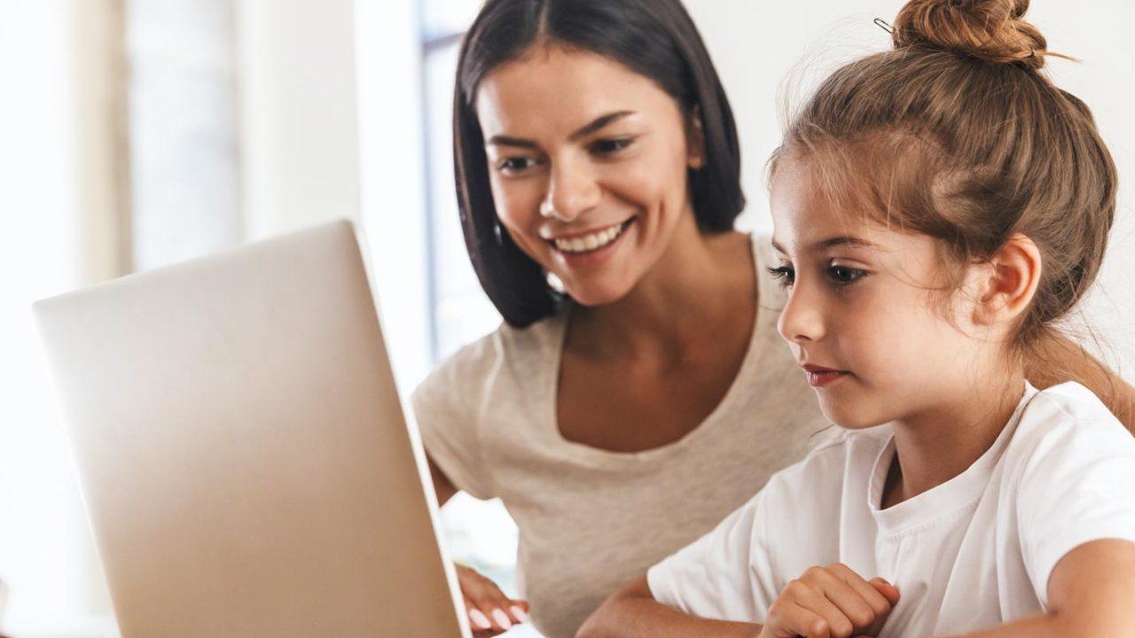 mother with daughter online school