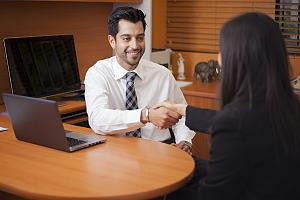 Family law attorney with client at desk