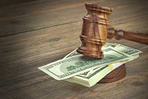 Gavel on top of Alimony money