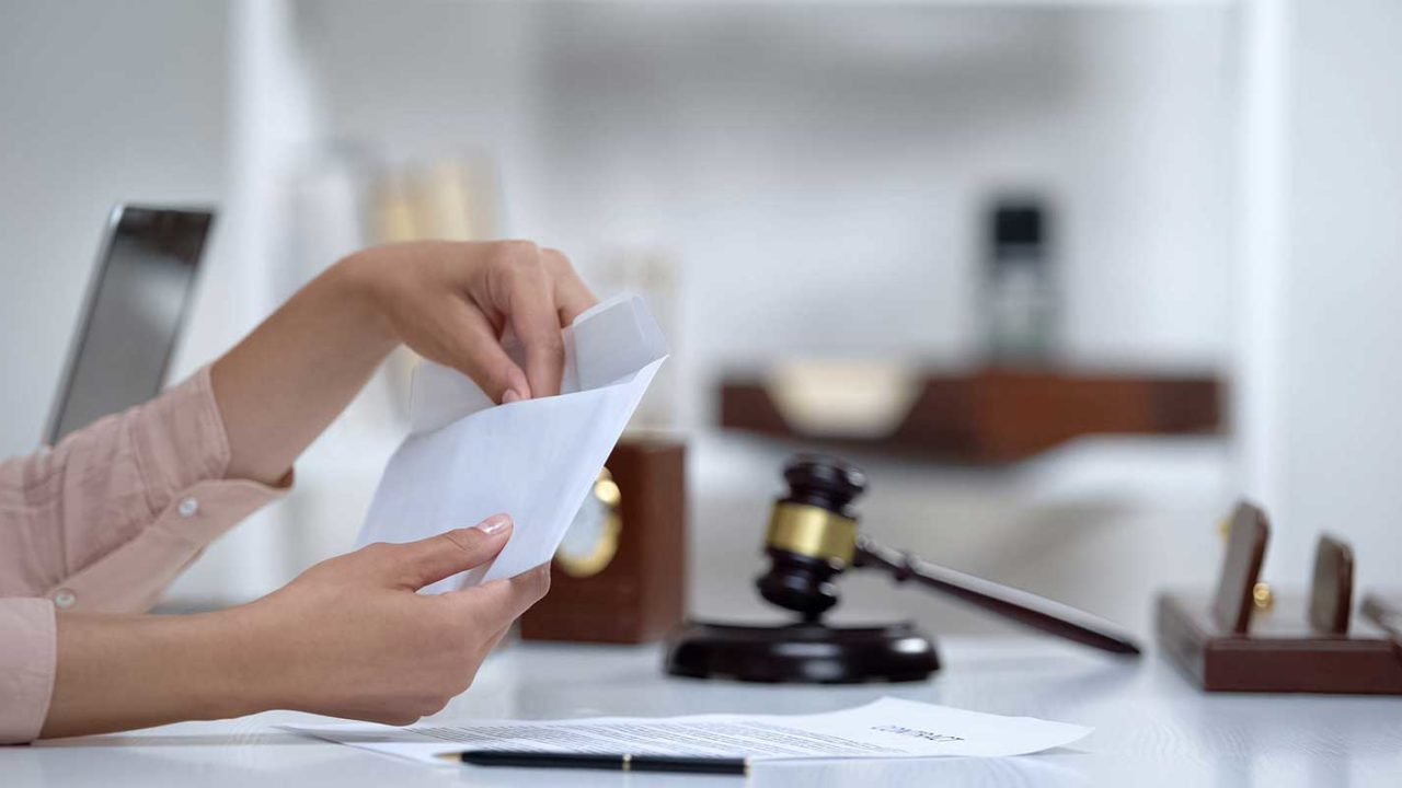 Maryland family law attorney checking clients alimony check