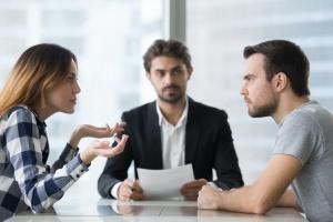 couple arguing in divorce mediation