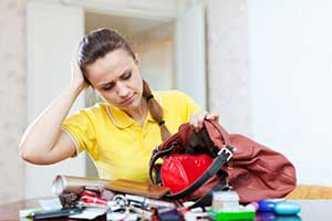 Woman searching through her purse for inheritance papers that prove ownership